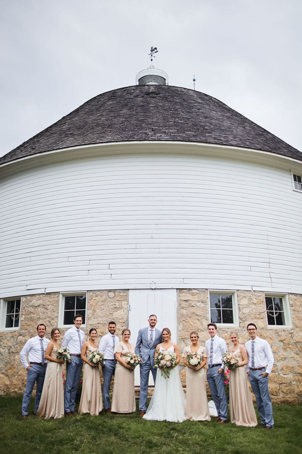 Wedding party in front of the Round Barn